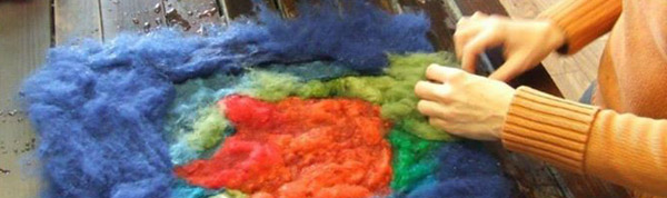 Female hand working with felt